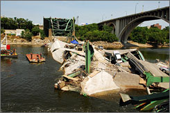 Navy divers survey the wreakage of the Interstate 35W bridge collapse in Minneapolis.