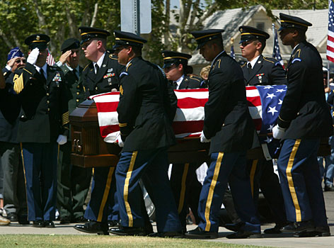 Members of the U.S. Army Honor Guard carry the flag -draped casket of U.S. Army Cpl. Nathan Hubbard, to a funeral home in Clovis, Calif. Hundreds of people lined the streets Wednesday to watch the procession of Hubbard, the second son in his family killed in the Iraq war. 