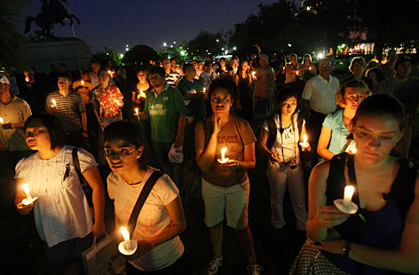 Mourners gather during a candelight vigil in Jackson Square for victims of Hurricane Katrina, Wednesday, in New Orleans, on the second anniversary of Hurricane Katrina.