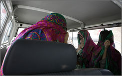 Three released South Korean hostages sit in a vehicle in the city of Ghazni, Tuesday.