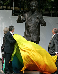 The nine-foot bronze statue is unveiled in Parliamentary Square by Britain's Prime Minister Gordon Brown, center, and London's Mayor, Ken Livingstone, right. In his autobiography, Mandela joked that perhaps someday his statue would stand there.
