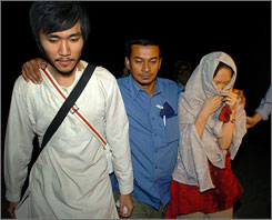 South Korean hostages walk with officials from The International Committee of the Red Cross after being released by their Taliban captors in Janda.