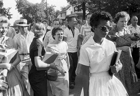 Hecklers, including Hazel Bryan, jeering at center, follow Elizabeth Eckford as she walks away from Little Rock's Central High School. Eckford was turned away by Arkansas National Guardsmen, who were instructed by Gov. Orval Faubus not to allow nine black students to enter the school, despite federal court orders.
