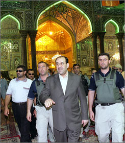 Iraqi Prime Minister Nouri al-Maliki leaves the shrine of Imam Hussein as he visits the Shiite holy city of  Karbala on Wednesday,