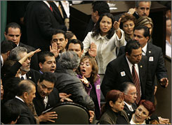 Lawmakers scuffle before the arrival of Mexican President-elect Felipe Calderon at the National Congress for his swearing-in ceremony. Lawmakers tried unsuccessfully to block the ceremony in Mexico City on Dec. 1, 2006.