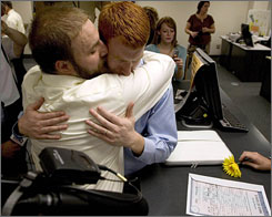 Tim McQuillan, right, and Sean Fritz, both Iowa State University students, hug on Friday after obtaining a marriage license at the Polk County recorder's office in Des Moines. The couple then asked a judge to sign a waiver allowing them to marry today rather than wait three days, as is required by law.