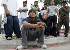 Pedro Delgado,  a day laborer  from Monterrey, Mexico, talks about looking for work in Dallas, May 31, 2007. Sites where day laborers gather to find jobs have become tense, as groups like the Texas Minutemen, which reports illegal immigrants, make their presence known by taking photos of the workers and contractors' cars.