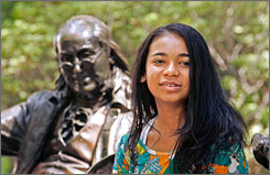 Brittney Exline, 15, of Colorado Springs, Colo., is shown with a statue of Benjamin Franklin, the founder of the University of Pennsylvania, on the campus in Philadelphia, Tuesday, Aug. 28.