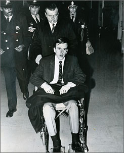 Philadelphia police officer Walter T. Barclay, seated in a wheelchair, is taken to the courtroom to testify during the trial of his accused assailant, William Barnes, in this 1968 photo, in Philadelphia. Barnes served a 15-year sentence for attempted murder for the crime.