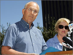 U.S. Senator Larry Craig, R-Idaho, addresses a news conference with his wife Suzanne at his side in Boise, Aug. 28. His spokesman said Tuesday that the senator was reconsidering his resignation pending the outcome of his court and Congress ethics cases. 