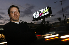 "Mark Legan of Los Angeles lives near this billboard. Clear Channel Outdoors, operator of the sign, calls  the billboards ""incredible technology."" It says the company is experimenting with ""the best way . . . to serve our customers."""