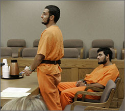 Youssef Samir Megahed, 21, stands as co-defendent Ahmed Abdellatif Sherif Mohamed, 24, looks on during a bond hearing Aug. 6, at the Berkeley County Court House in Moncks Corner, S.C. The two Egyptian students were indicted Aug. 31., on charges of carrying explosive materials across states lines.