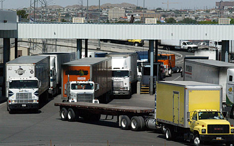 Mexican trucks make their way into the United States at the Bridge of the Americas port of entry's inspection area in June 2004, in El Paso, Texas. The Bush administration urged a federal appeals court Thursday to let Mexican cargo trucks cross the border and travel freely anywhere in the country, arguing that to do otherwise could strain diplomatic relations between the U.S. and Mexico.