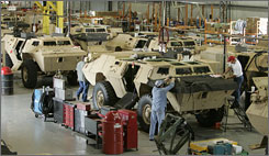 "Armored Security Vehicles are being serviced at the Textron factory in Slidell, La. Sen. Mary Landrieu is credited with keeping funding for the ASV program alive by using a process called ""earmarking."""