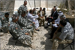 U.S. military and Iraqi government officials meet with tribal leaders to discuss cooperation and security matters at Patrol Base Murray south of Baghdad on Monday.
