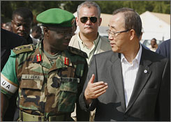 United Nations Secretary-General Ban Ki-moon, right, talks to African Union Force Commander General Martin Agwai of Nigeria during his visit to the north Darfur capital of El Fasher, Sudan, Wednesday.