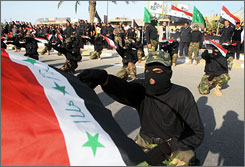 Mahdi Army militiamen affiliated with Shiite cleric Muqtada al-Sadr, parade during a rally in the southern city of Basra in November.