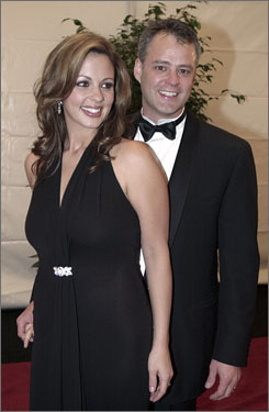 Country singer Sara Evans, seen in this 2001 photo with her husband, Craig Schelske, has previously alleged that there are nude photos of him having sex with other women.