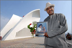 Jones poses with a portrait of himself and his late wife at the 9/11 Memorial Thursday. Felicia Dunn-Jones' name has been added to the list of victims of the attacks on the World Trade Center and will be read on the sixth anniversary Tuesday.