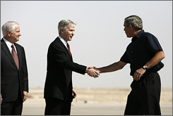 U.S. Ambassador to Iraq Ryan Crocker, center, welcomes President Bush at the Al-Asad Air Base in Anbar province on Sept. 3. Defense Secretary Robert Gates stands at left.