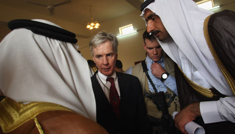 U.S. ambassador to Iraq Ryan Crocker speaks with tribal leaders during a meeting between Iraqi and American government officials and Sunni sheikhs on September 6 in Ramadi. Crocker speaks fluent Arabic.