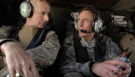 This photo released by the U.S. Department of Defense shows Gen. David Petraeus, right, and Chairman of the Joint Chiefs of Staff Peter Pace on their way to the Green Zone in Baghdad on July 16.