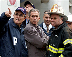 Rudy Giuliani shows President Bush, Gov. George Pataki, second from left, and Sen. Charles Schumer, second from right, the World Trade Center site Sept. 14, 2001, with Fire Commissioner Thomas Van Essen.