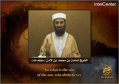This frame grab taken from an undated video message provided Tuesday, Sept. 11, by IntelCenter, a U.S. government contractor monitoring al-Qaeda messaging, shows Osama bin Laden raising his finger while speaking.