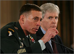 """Gen. David Petraeus, left, with Ambassador Ryan Crocker, warned that a """"premature"""" pullback of  U.S. forces in Iraq would risk catastrophe. The two testified Monday before more than 100 members of the House of Representatives."""