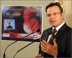 Austrian Interior Minister Guenter Platter announces the arrest of three suspected al-Qaeda activists in connection with a videotape threatening reprisals against Vienna and Berlin for their role in Afghanistan, Wednesday.