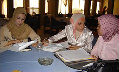 Wafa'a al-Dulaimi, left, Jenan al-Juburi, center, and Thikra Muslim meet in the cafeteria of the Iraqi Association Bar of lawyers in Baghdad.