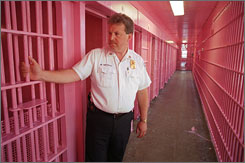 Buffalo police Capt. Mark Antonio displays a newly painted pink cellblock in Buffalo. The pink paint job stems from police research that found this particular color can reduce aggressiveness in prisoners.