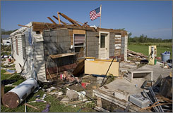 The home of Jack and Connie Payton sits abandoned after it was severely damaged by Hurricane Humberto Friday in High Island, Texas. After the house was deemed a total loss, the couple moved in with relatives while they wait to rebuild their home.