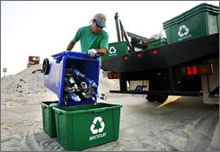 Todd Phillips empties a recycling bin in Rodanthe, N.C.