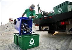 Todd Phillips empties a recycling bin in Rodanthe, N.C.