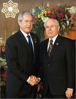 President Bush is greeted by Australian Prime Minister John Howard at the Asia-Pacific Economic Cooperation (APEC) meeting in Sydney.