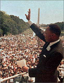 "The Rev. Martin Luther King Jr. acknowledges the crowd at the Lincoln Memorial for his ""I Have a Dream"" speech during the March on Washington, D.C., Aug. 28, 1963."