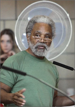 This file photo from April 12, 2006, shows Sen. Ernie Chambers of Omaha during debate in the legislative chamber in Lincoln, Neb. Chambers is seeking a permanent injunction against the Almighty, because he says God has made terroristic threats against the senator and his constituents.
