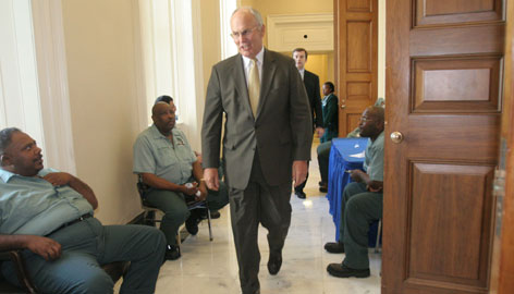 Sen. Larry Craig, R-Idaho, greets employees on Capitol Hill in Washington, Tuesday. Craig returned to the Senate for the first time since public disclosure of his guilty plea in a restroom sex sting.