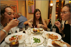 Leslie Lipton enjoys a meal at an Italian restaurant in New York City. Lipton, a reformed ?shy eater? who also suffered from an eating disorder, now speaks to kids about this problem.