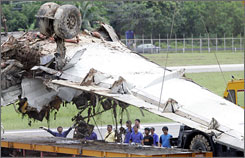 Wreckage of the Thai One-Two-Go Airlines Flight OG269 is removed from the airport in Phuket, Thailand.