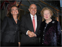 U.S. presidential hopeful Rudy Giuliani, joined by his wife Judith, left, meets with former British prime minister Margaret Thatcher Wednesday in London. Giuliani spoke to The Atlantic Bridge, where he received the Margaret Thatcher Freedom Award.