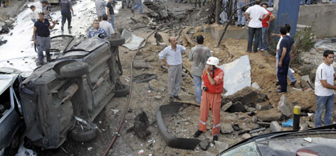 Lebanese Red Cross and civilians inspect the area of an explosion in eastern Beirut. Several people were killed in a car bomb attack there on Wednesday, security sources said.