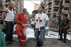 Red Cross workers carry a victim after the explosion. At least 20 people were wounded in the blast.