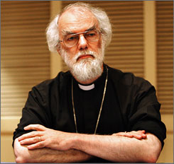 Rowan Williams, archbishop of Canterbury and the Anglican spiritual leader, speaks to reporters in New Orleans on Friday.