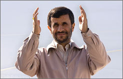Iranian President Mahmoud Ahmadinejad waves to officials as he leaves for the United Nations in New York from Tehran's Mehrabad airport, Friday.