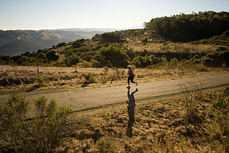 Forever young:Lydia Nayo, 55, of Oakland runs 6 miles through Tilden Regional Park in Berkeley to prepare for a half-marathon  and stay ahead of the ills of aging.