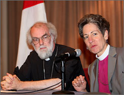Rowan Williams, left, archbishop of Canterbury and the Anglican spiritual leader, and Presiding Bishop Katharine Jefferts Schori, head of the Episcopal Church, speak to reporters in New Orleans, Friday.
