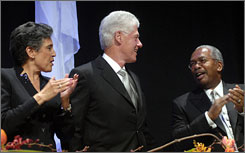 Former President Bill Clinton, center, is seen with Carlotta Walls Lanier, left, and Ernest Green, two of the students who helped desegregate Little Rock Central High School in 1957, during a Little Rock Nine Foundation gala, Monday.