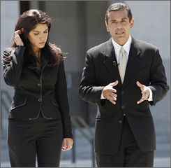 Los Angeles Mayor Antonio Villaraigosa, right, walks with television reporter Mirthala Salinas, in Sacramento, Calif., in June 2006.  Salinas has been reassigned from to a new position at Telemundo.